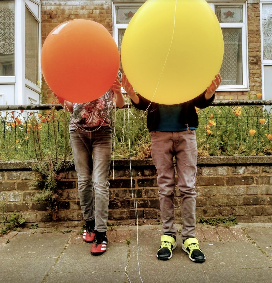 Giant biodegradable balloons can be bought for about a pound each with a little online research. Take my advice and invest in a little rechargeable air pump.