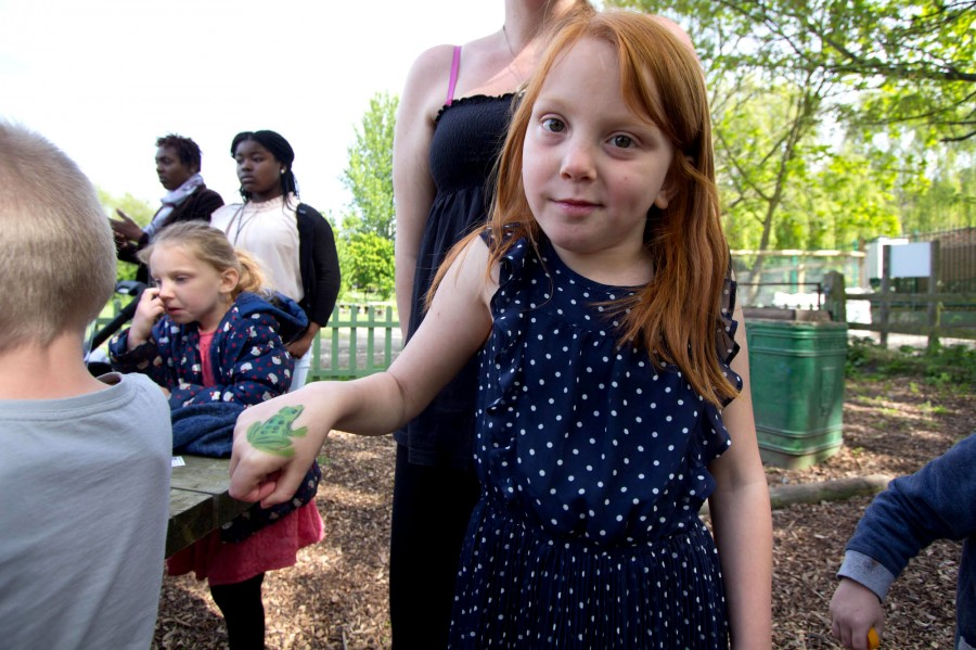 A young visitor shows off her frog!